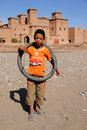Boy In Front Of Kasbah In Skoura Stock Images - 24439504
