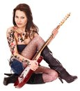 Girl With Tattoo Playing Guitar. Stock Image - 24459321