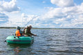 Father And Son Fish In Boat Stock Photos - 24477253