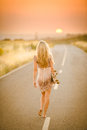 Girl Walking With Her Skateboard Royalty Free Stock Image - 24495226