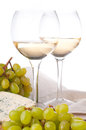 Two Glasses Of White Wine, Cheese And A Grapes Royalty Free Stock Images - 24496919