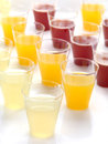 Plastic Glasses Full Of Fresh Juice Stock Photos - 24500653