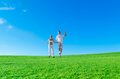 Happy Excited Couple Jumping Together Royalty Free Stock Image - 24502296