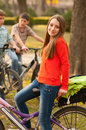 Teenage Girl Riding Bicycles With Her Friends Royalty Free Stock Images - 24511199