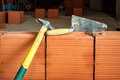 Hammer And Trowel On Construction Site Stock Images - 24547444