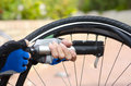 Pumping Up Repaired Bike Tyre Stock Image - 24550861