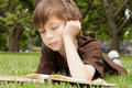 Boy Reading A Book Stock Photo - 24565540