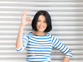 Lovely Teenage Girl Showing Ok Sign Stock Photos - 24579163
