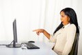 Business Lady Pointing The Computer Screen Stock Photo - 24581120