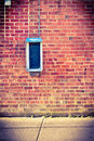 Brick Wall With Payphone Royalty Free Stock Image - 24608326