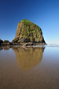Beautiful Reflection Of Haystack Rock Stock Images - 24615114