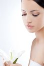 Woman Holding Lily Flower, Spa Theme Stock Images - 24621154