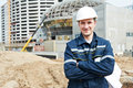 Foreman At Construction Site With Working Drawings Royalty Free Stock Photography - 24657777