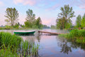 Landscape With Boat And Footbridge On The River Royalty Free Stock Image - 24666506