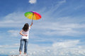 Umbrella Woman And Blue Sky Royalty Free Stock Photography - 24667417
