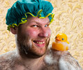 Happy Man With Duck Toy Royalty Free Stock Photo - 24673225