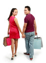 Attractive Happy Couple Carrying Shopping Bag Royalty Free Stock Photography - 24691787
