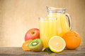 Fresh Fruits Juice In Glass And Slices On Wood Royalty Free Stock Photo - 24697465