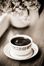 Coffee And Bouquet In Sepia Royalty Free Stock Photo - 24701035