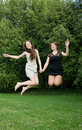 Two Young Cheerful Women Jumping Royalty Free Stock Photography - 24709147