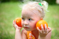 A Child With Oranges Royalty Free Stock Photography - 24715677