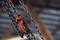 Red Hoist And Chain On Background Royalty Free Stock Photos - 24733738
