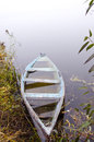 Sunken Wooden Boat With Water Stand On River Shore Stock Images - 24757414