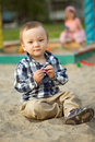 Child Playing In The Sand Stock Photo - 24784430