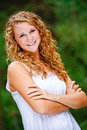 Pretty Teenage Girl Curly Hair Arms Crossed Stock Images - 24798104