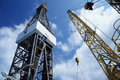 Jack Up Oil Rig (Drilling Rig) And Rig Crane Royalty Free Stock Images - 24843859