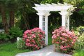 Garden Arbor And Pink Flowers. Royalty Free Stock Photo - 24844105