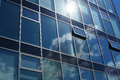 Clouds Reflected In Windows Of Office Building Royalty Free Stock Images - 24853469