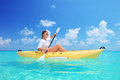 A Woman Kayaking On A Sunny Day Stock Images - 24862404