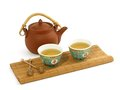 Clay Teapot And Cups Of Tea Isolated On White Royalty Free Stock Photos - 24879048