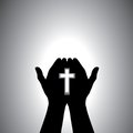 Devout Christian Worshiping With Cross In Hand Stock Photos - 24880953