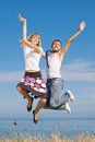 Guy In Tie And Slim Girl Jumping Royalty Free Stock Photos - 24883708