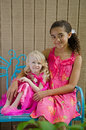 Two Young Girls In Pink On Blue Bench Stock Photos - 24922213