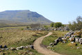 Footpath Past Limestone Pavement To Ingleborough. Stock Photo - 24928780