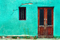 Old House Wall With Wooden Door And Window Stock Photography - 24931942