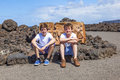 Two Teen Boys Sitting On A Rock And Have A Rest Stock Photo - 24935520