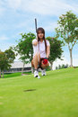 Lining Up A Putt On The Green Stock Photos - 24980703