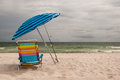 Beach Umbrella And Chair Royalty Free Stock Images - 25019009