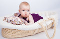 Cute Little Baby Fashion Lies In The Basket Stock Photo - 25055610