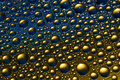 Blue Ang Gold Drops Stock Photography - 25069002