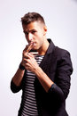 Casual Man Lighting His Cigarette Stock Photography - 25079112