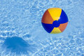 Inflated Plastic Ball Flying In The Pool Stock Photo - 25097620
