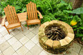 Adirondack Chairs And Fire Pit Stock Photography - 25104382