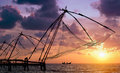 Sunset Over Chinese Fishing Nets In Cochin Stock Photos - 25104523
