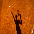 Shadow Of A Tennis Player In Action Stock Photos - 25110003