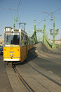 Tram Coming From Freedom Bridge In Budapest Royalty Free Stock Photography - 25111707
